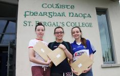 Triplets collecting their exam results.